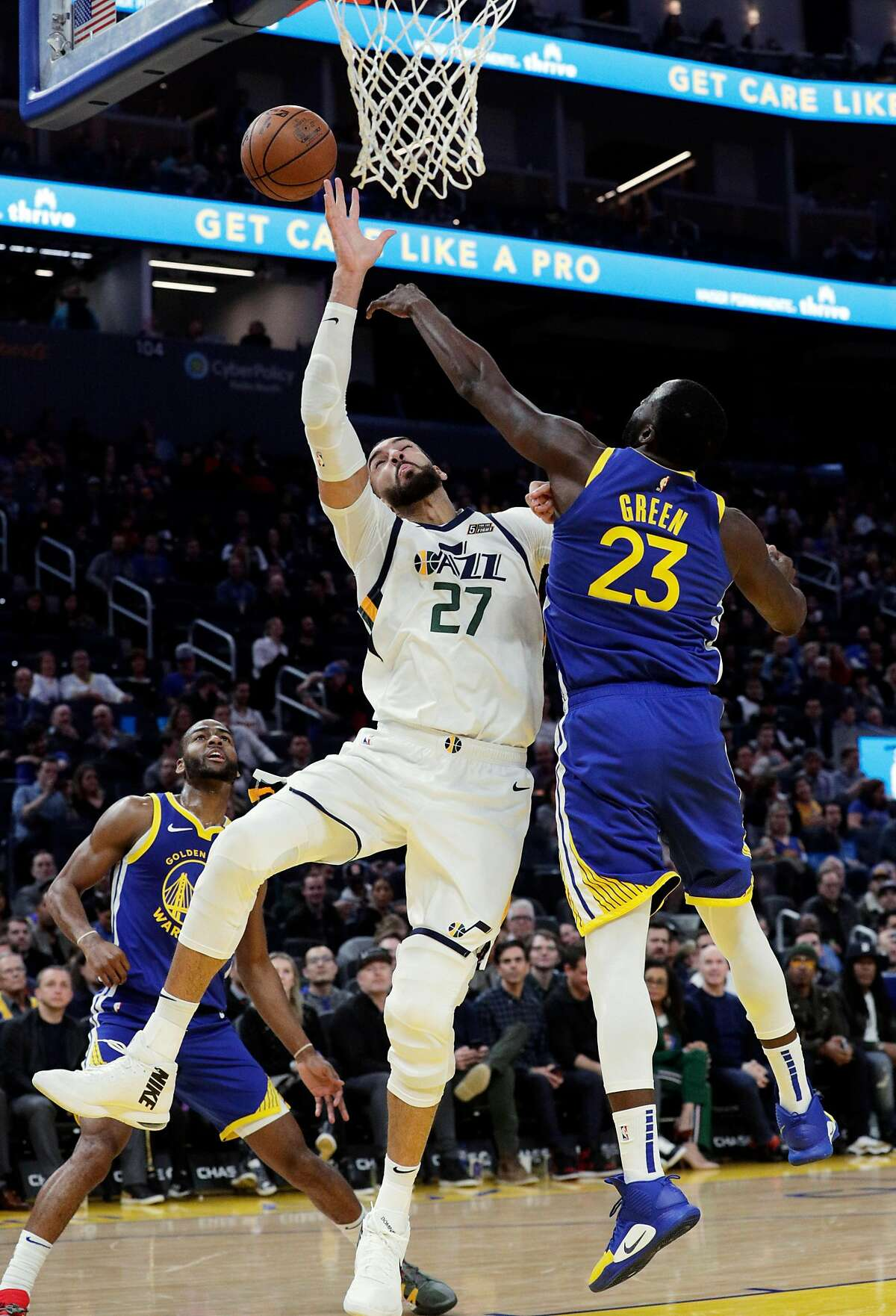 Draymond Green (23) deflects a pass intended for Rudy Gobert (27) in the first half as the Golden State Warriors played the Utah Jazz at Chase Center in San Francisco, Calif., on Wednesday, January 22, 2020.