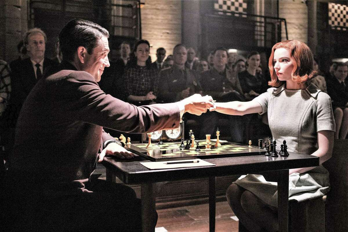 Beth Harmon (Anya Taylor-Joy) faces off with her toughest Russian opponent Vasily Borgov (Marcin Dorocinski) in the finale of Netflix series 'The Queen's Gambit.'.