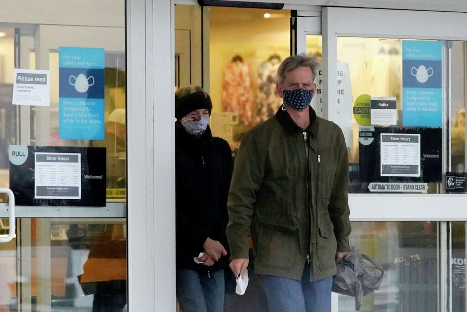 Shoppers wear masks as they leave a store. Photo: Nam Y. Huh | AP / Copyright 2020 The Associated Press. All rights reserved.