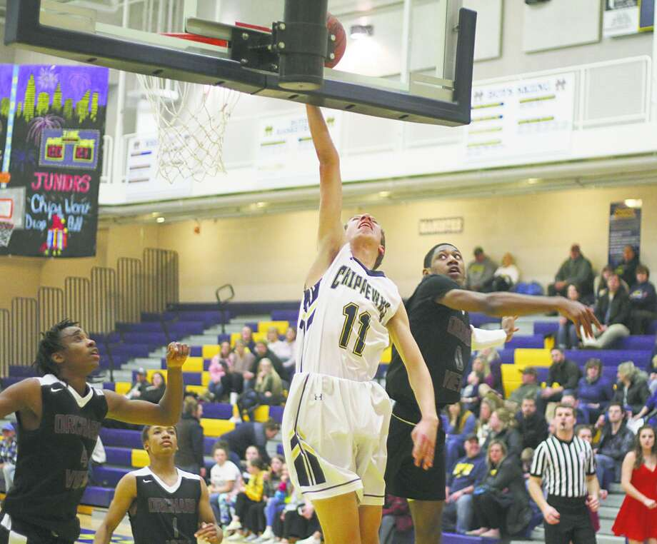 Manistee's Grant Schlaff lays it up last season at home. Prep sports across the state have been on hold since Dec. 7. Photo: File Photo