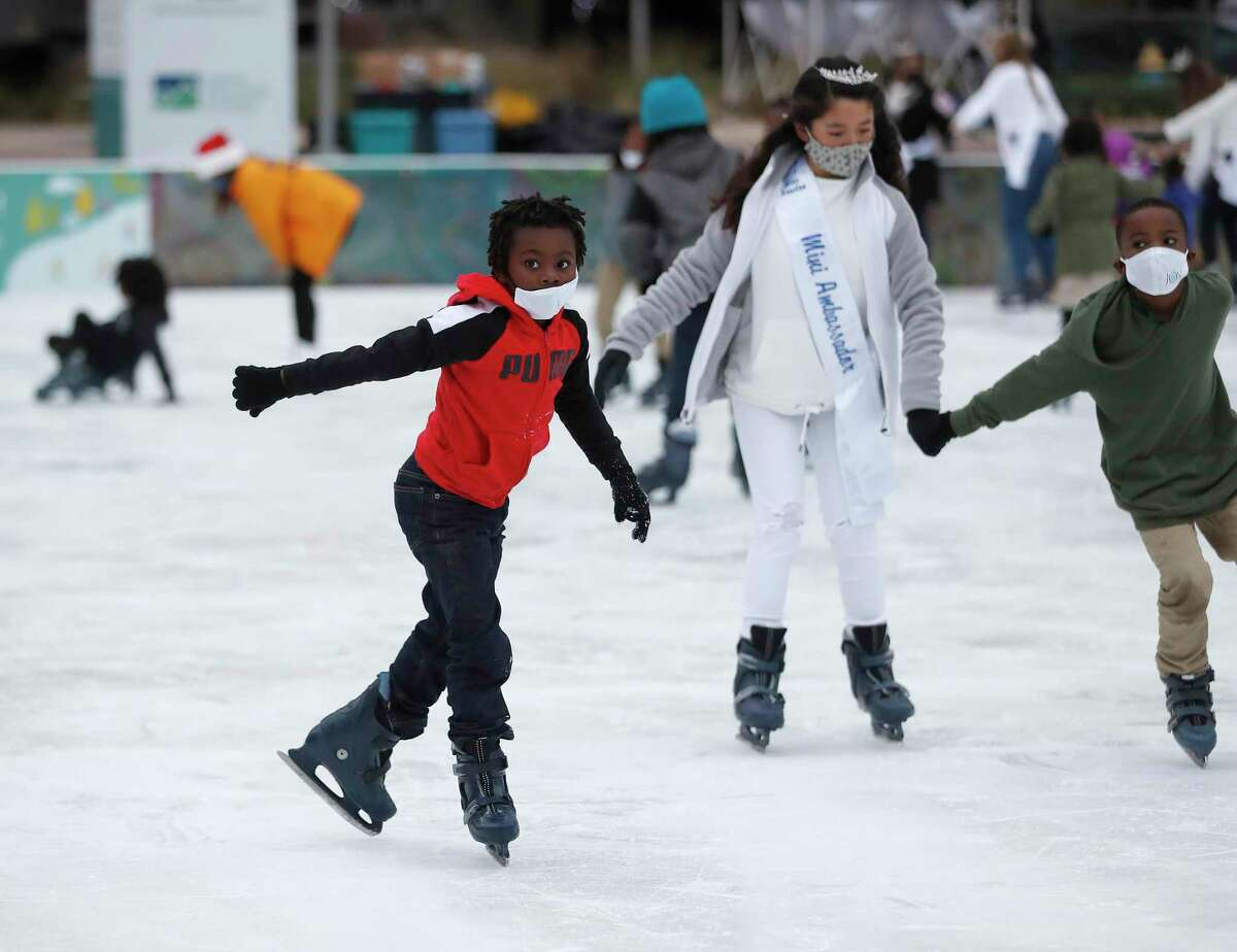 First-time skater Ishmael Mohammad, 7, takes to the ice as he and other children from the Houston Southside Community Center skated during the 5th annual Year of Joy Holiday Ice Skating Party at Discovery Green.Monday, December 14, 2020, in Houston.