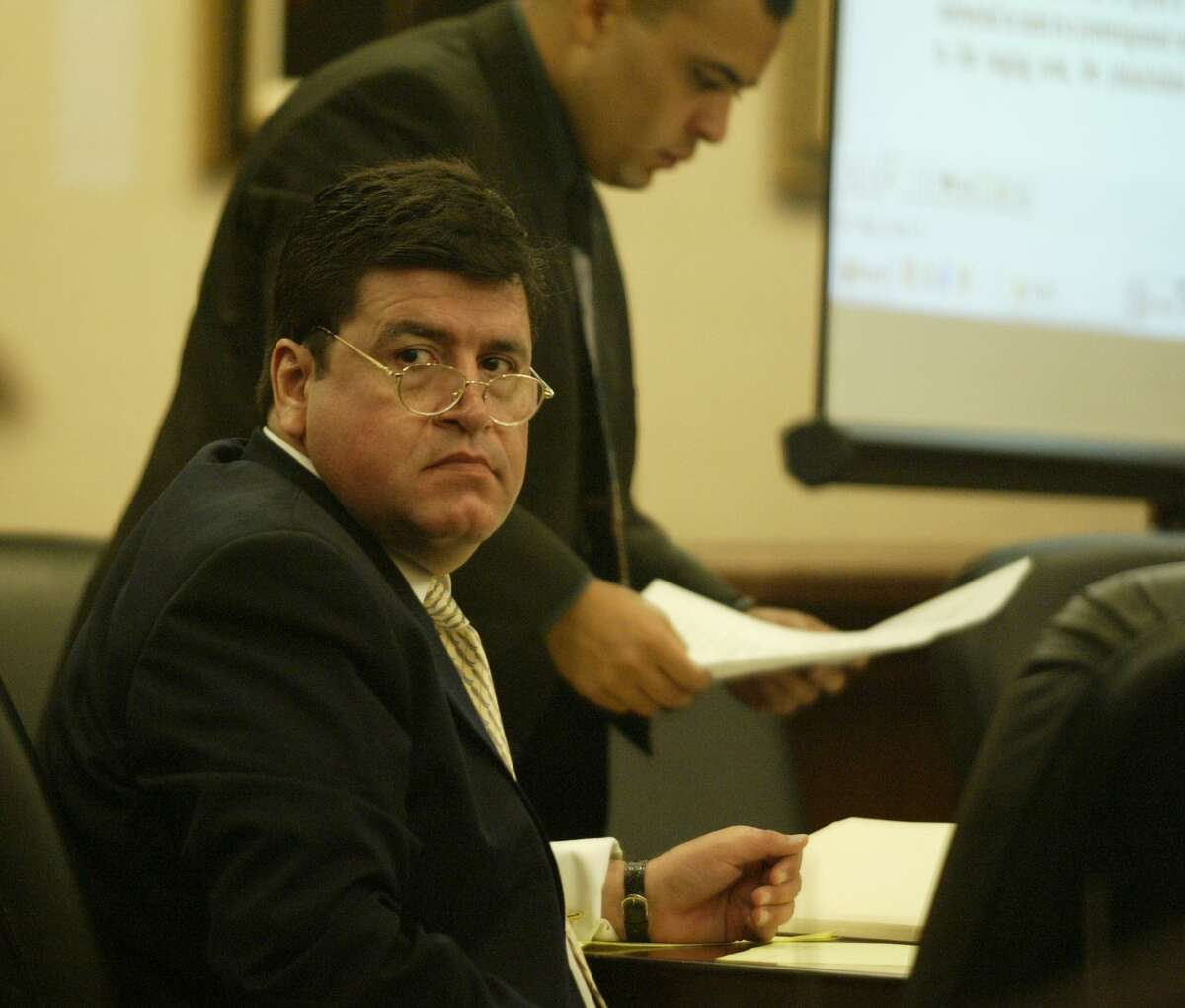 Former HPD Capt. Mark Aguirre, shown in this 2003 photo, is accused of aggravated assault with a deadly weapon for an incident in which he pulled over an air conditioning repairman and held him at gunpoint believing the man had 750,000 fraudulent mail-in ballots.