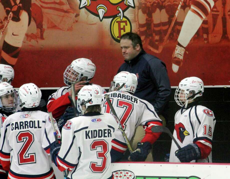 Big Rapids hockey coach Tim Blashill converges with his players during a game last season. (Pioneer file photo)