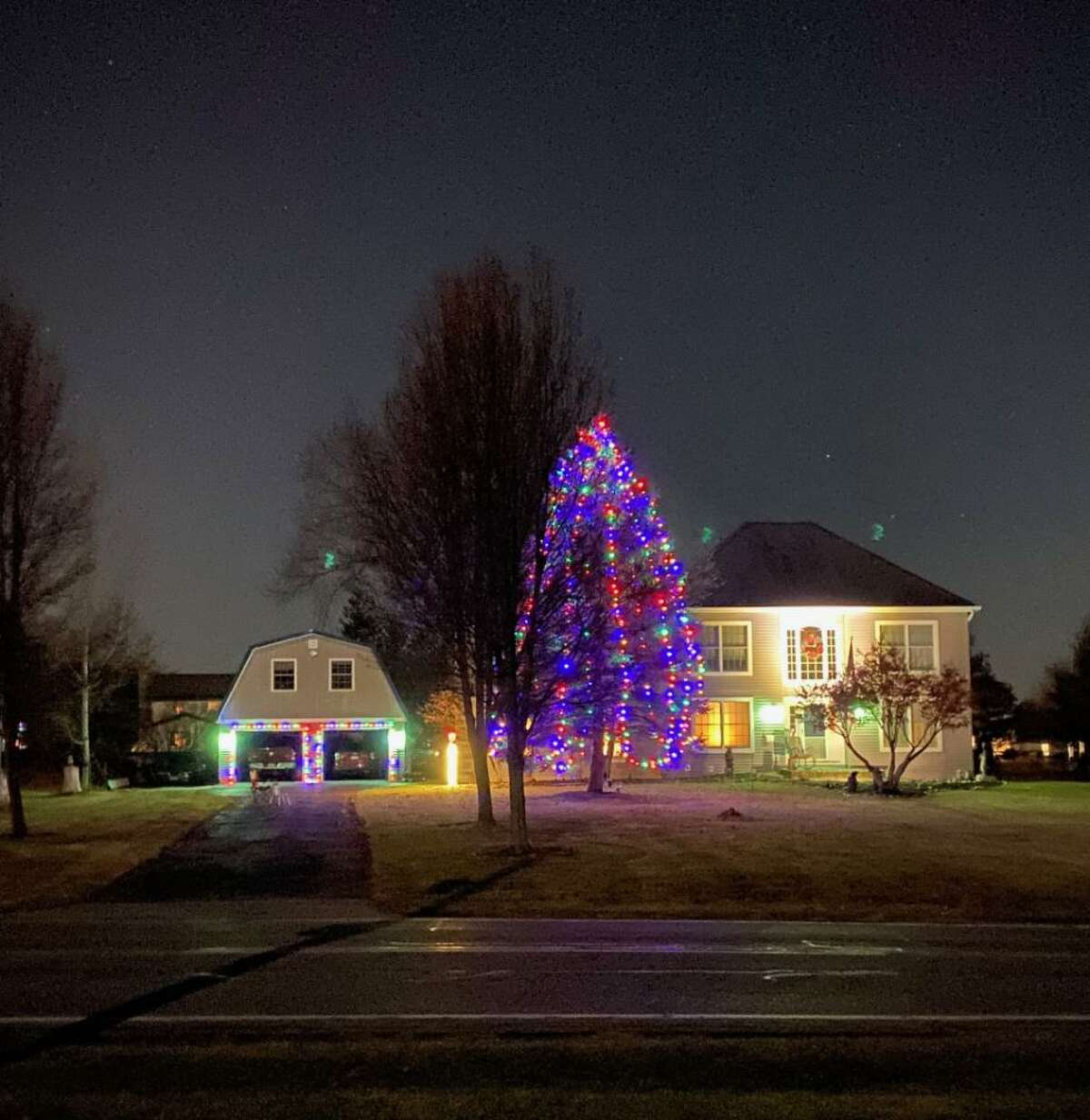 The Kohler family in Ballston Lake has been putting lights on the same tree in their front yard for at least 10 years.