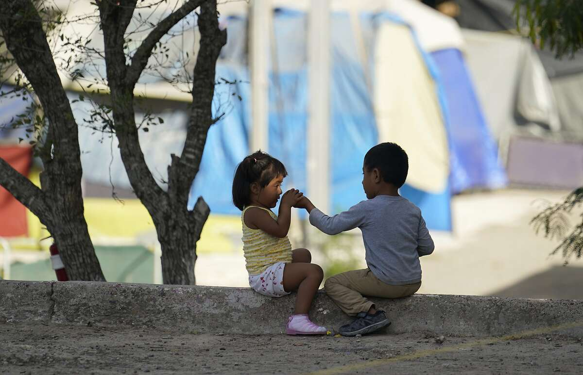 In this Nov. 18, 2020, file photo, children play at a camp of asylum seekers stuck at America's doorstep, in Matamoros, Mexico.