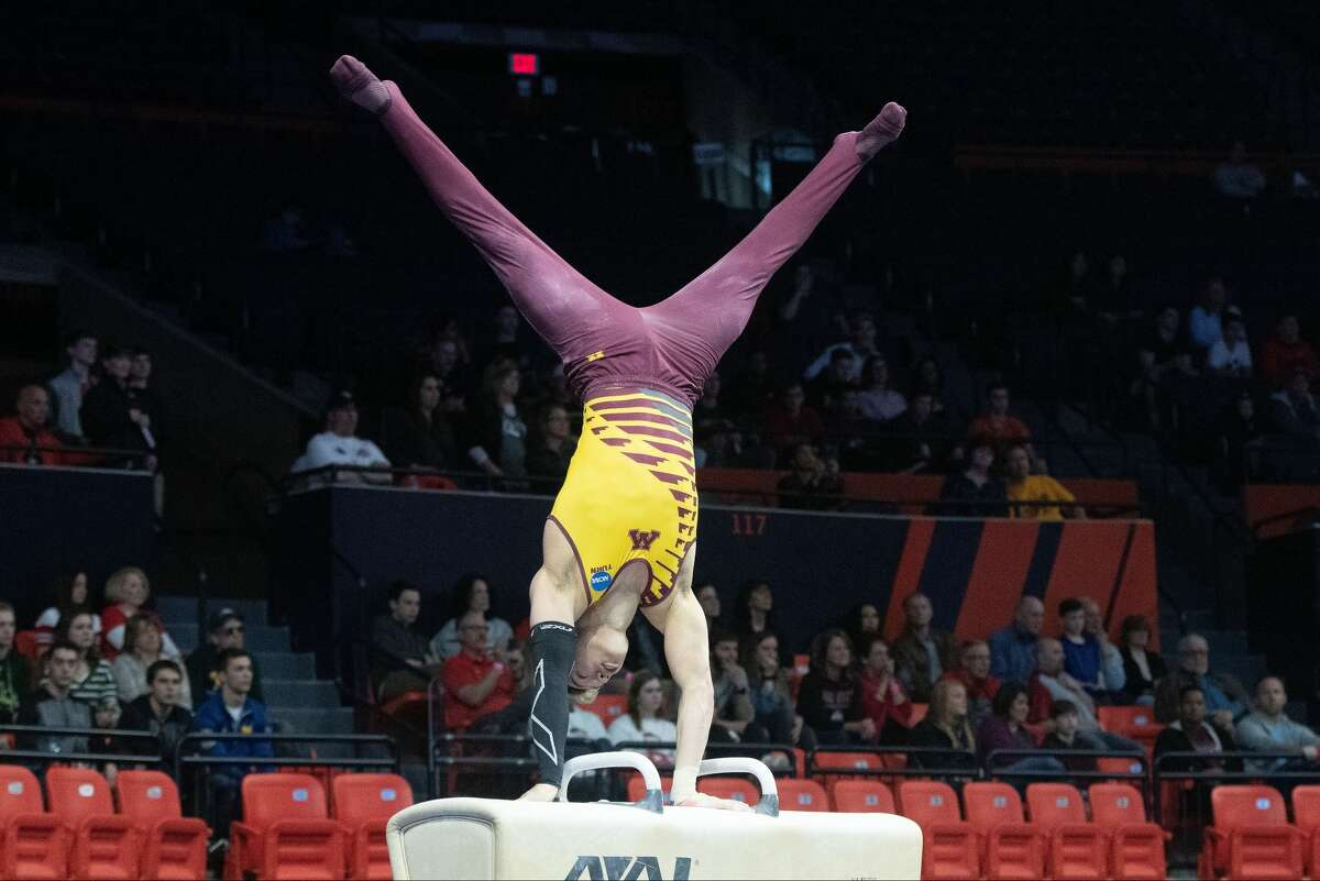 Justin Karstadt of the Minnesota Gophers competes during the Division I Men's Gymnastics Championship held at the State Farm Center on April 20, 2019, in Champaign, Ill.