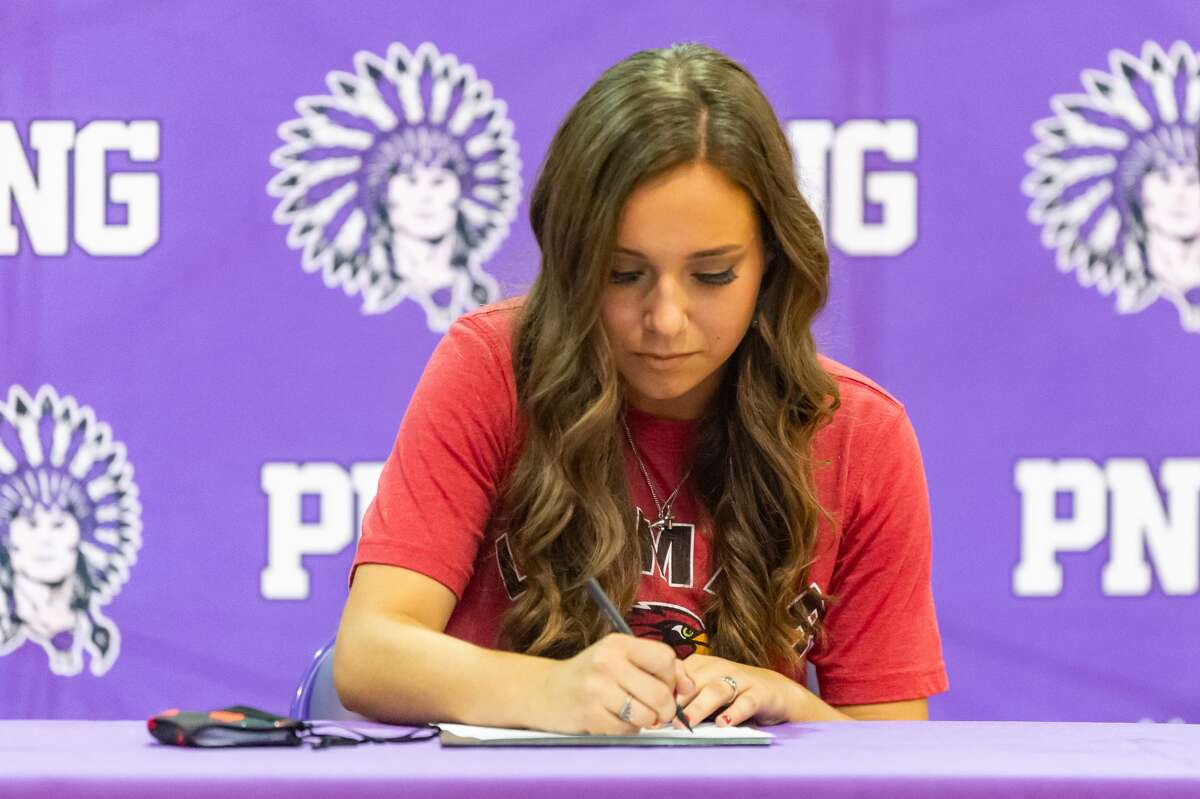 Port Neches-Groves girls soccer player, Grace Richard signs her commitment papers to play and continue her education at Lamar University. Photo made on December 15, 2020. Fran Ruchalski/The Enterprise