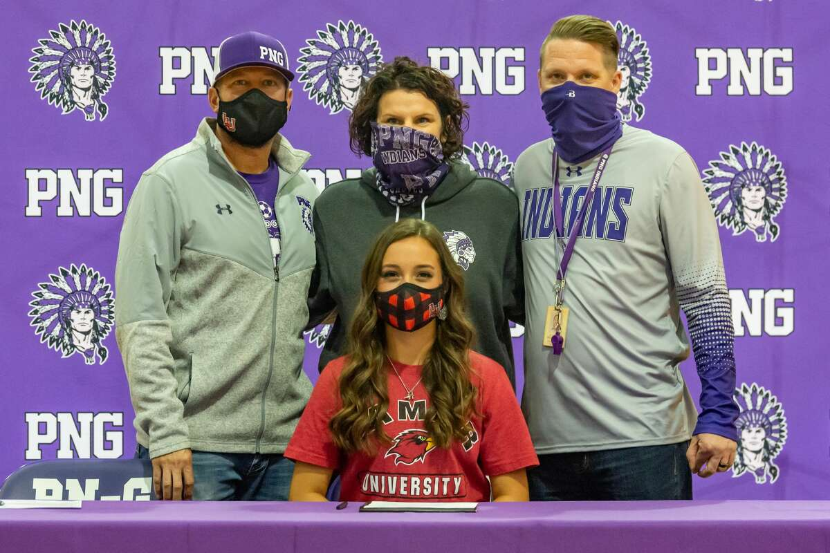 Port Neches-Groves girls soccer player, Grace Richard signed her commitment papers to play and continue her education at Lamar University. Behind her stand coaches Josh Tanner, from left, Aimee Bates, and Aaron Begnaud. Photo made on December 15, 2020. Fran Ruchalski/The Enterprise