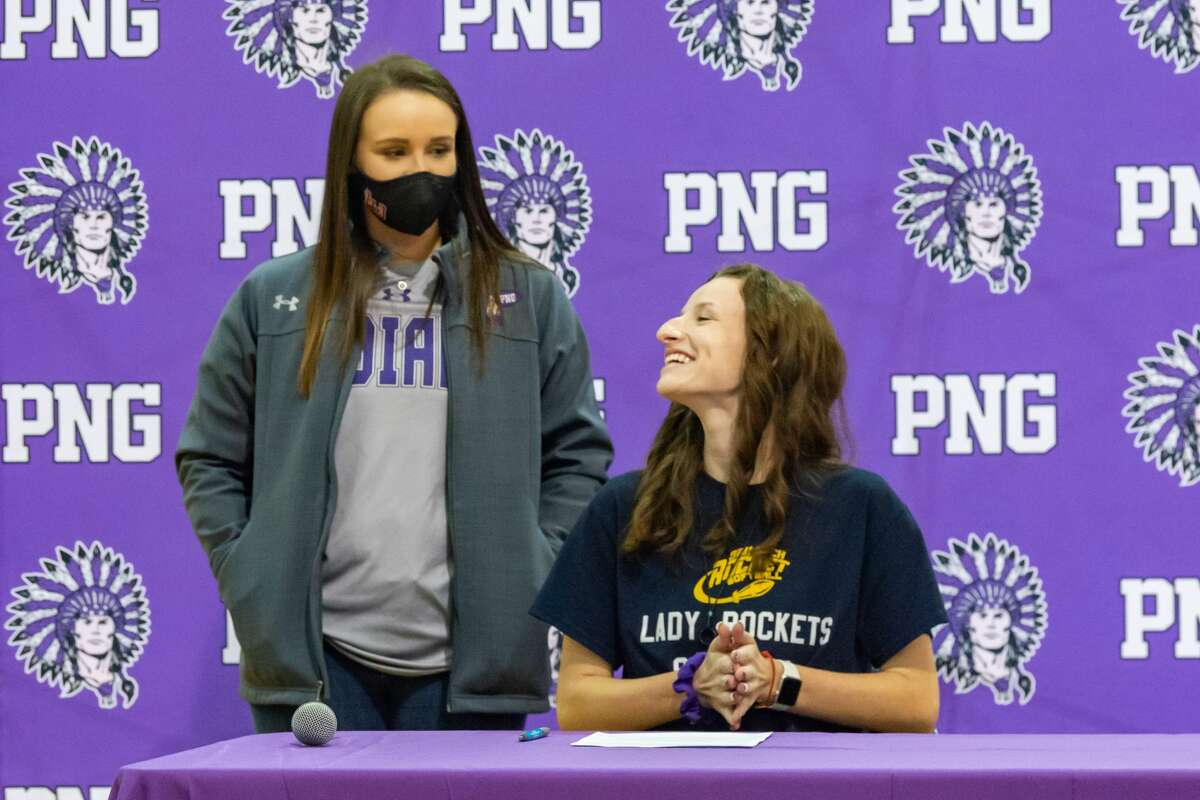 Port Neches-Groves girls softball player, Phoebe Borne signed her commitment papers to play and continue her education at Southern Arkansas University Tech. Behind her stands her coach, Taylor Harvill. Photo made on December 15, 2020. Fran Ruchalski/The Enterprise