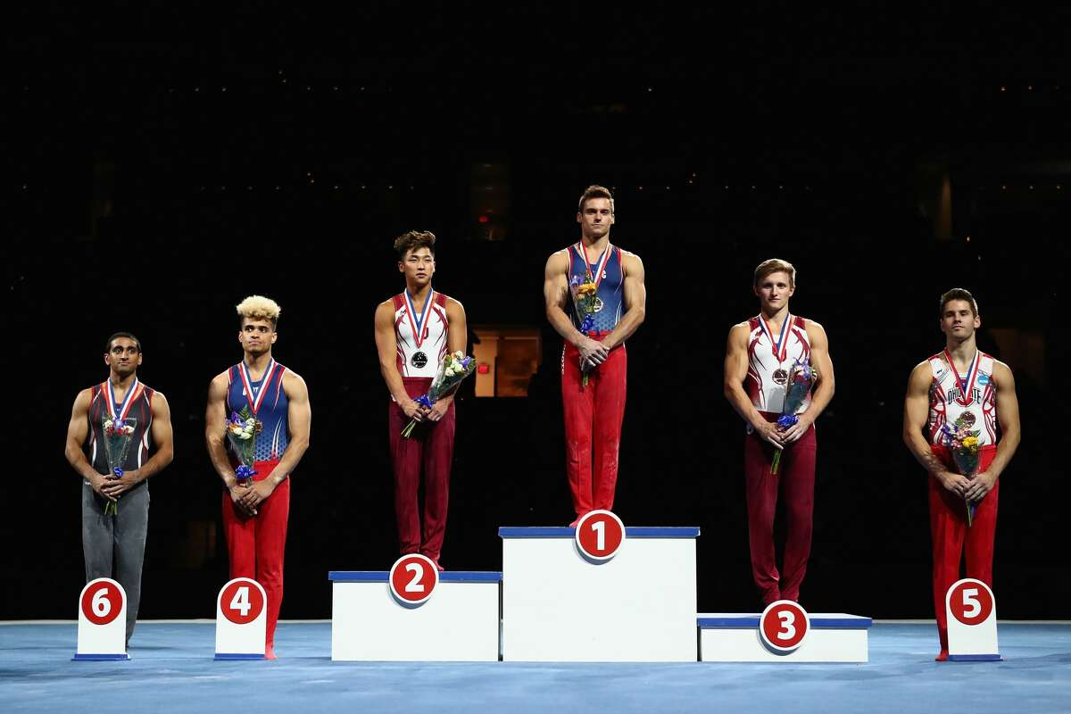 From left, Akash Modi of Stanford (6th), Donothan Bailey of USOTC (4th), Yul Moldauer of University of Oklahoma (silver), Sam Mikulak of USOTC (gold), Allan Bower of University of Oklahoma (bronze), and Alec Yoder of Ohio State (5th) pose during the Men's Senior All-Around medal ceremony at the U.S. Gymnastics Championships 2018 in Boston, Mass.