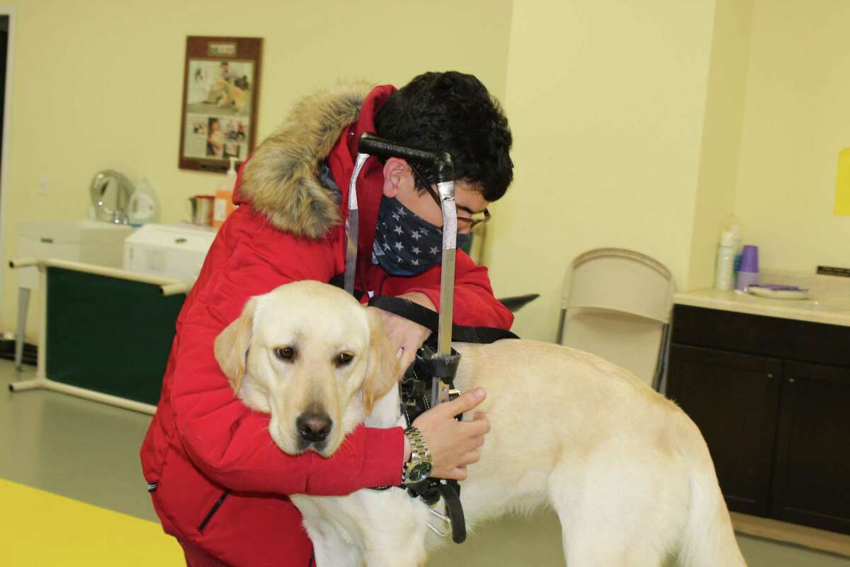 Anthony Turturro of Brooklyn, who suffers from injuries that affect his mobility and balance as the result of an accident, recently graduated with his new service dog, Libby, from ECAD. The facility, located in Winsted, is applying to expand with another building and more training areas.