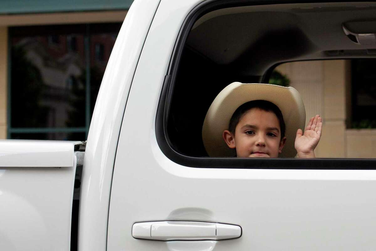 7-year-old Estevan Gonzalez waves to the gather crowd during the LULAC 17th Annual Cinco de Mayo parade, Saturday, May 2, 2009 in downtown Houston, Texas. Gonzalez' father was driving the truck that pulled the Franklin Elementary float during the parade. (Todd Spoth/Chronicle)