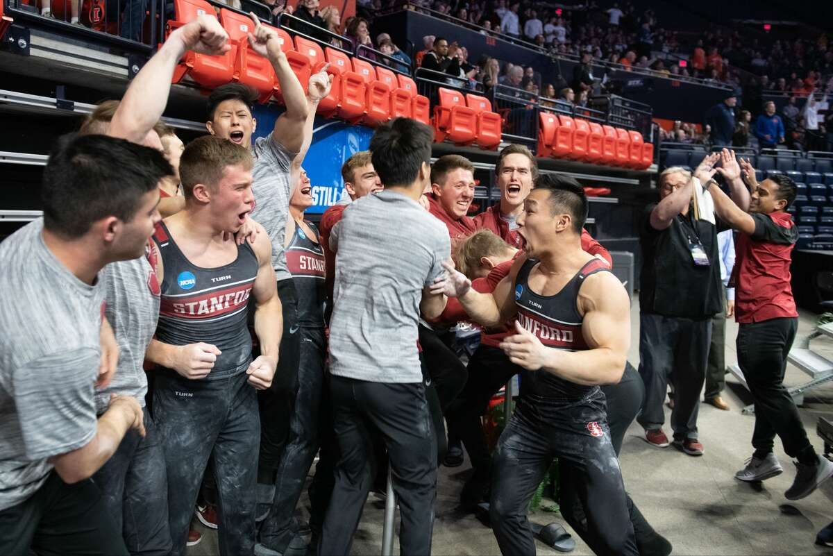 The Stanford Cardinal celebrates their win during the Division I Men's Gymnastics Championship held at the State Farm Center on April 20, 2019, in Champaign, Ill.