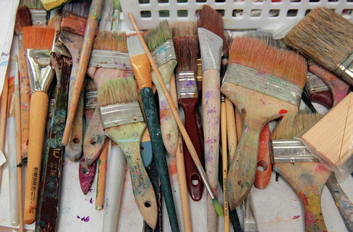 Artist Molly McDonald's paint brushes she used to created a mural on a door for the upcoming exhibit The Painted Doors of Branford in Branford, Conn., on Friday Oct. 30, 2020. TONK, an art gallery, has opened at 21 South Ave. in New Canaan, Conn. The art gallery held a gallery opening and holiday fashion fete Tuesday, Dec. 15 from 10 a.m. to 6 p.m.