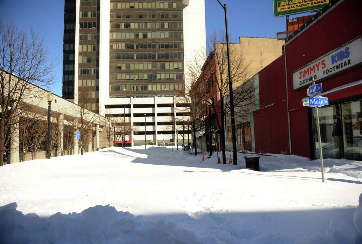 Wall Street remains unplowed in downtown Bridgeport, Conn. on Sunday, February 10, 2013.