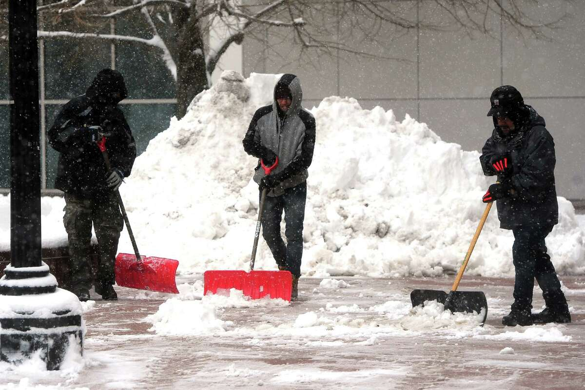 Cleanup begins Saturday morning following the overnight snow that fell in Bridgeport, Conn. March 2, 2019.
