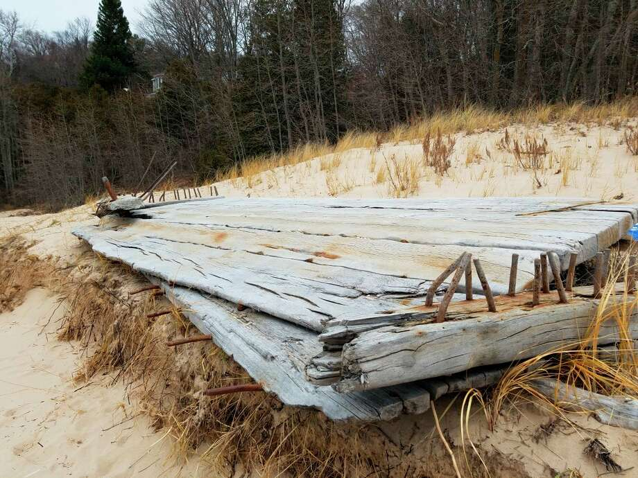 High water levels and wave action have pushed this section of a shipwreck out of the water and up along the beach at Frankfort. (Photo/Colin Merry)