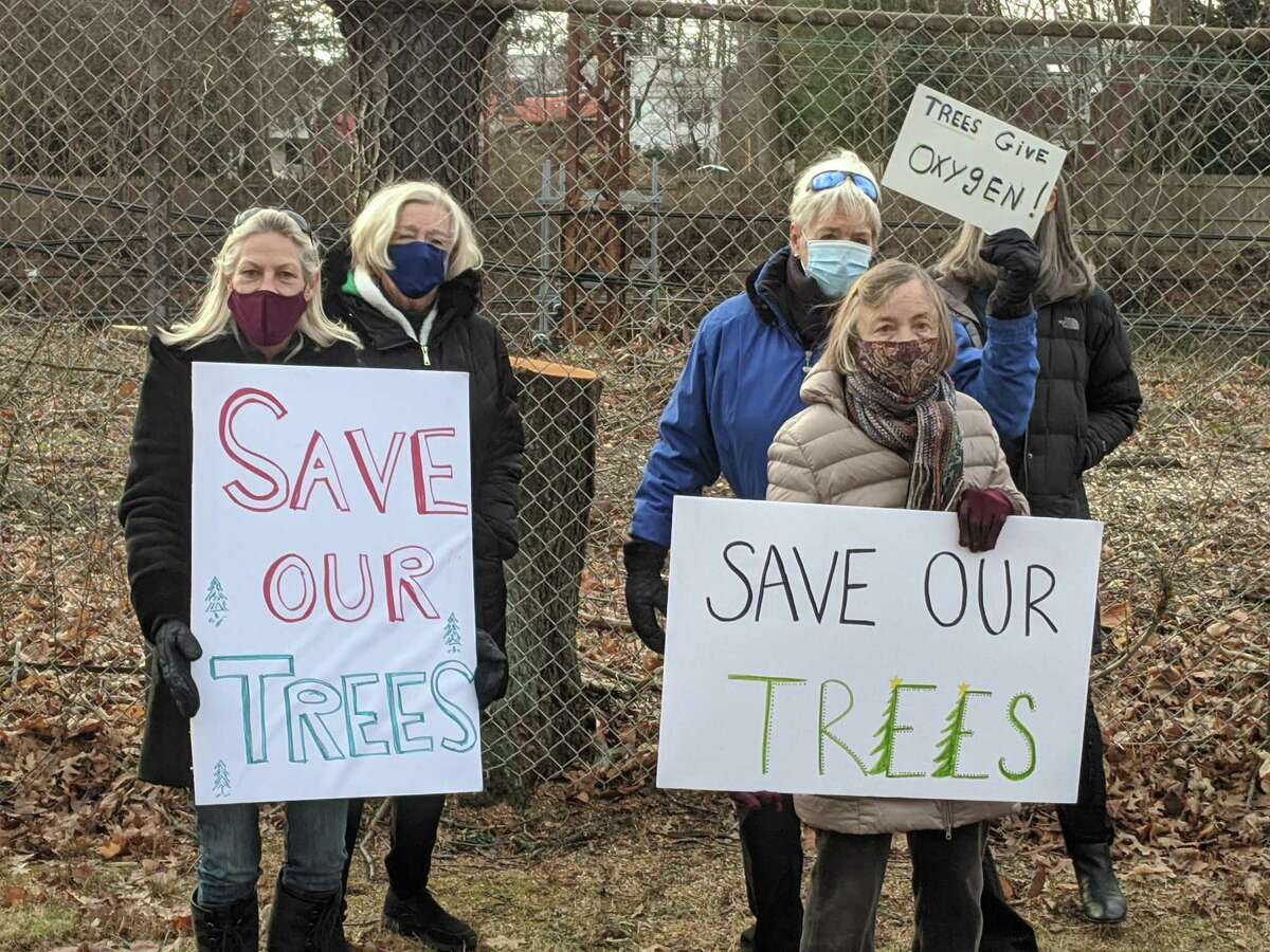 Protesters gather Dec. 15, 2020, near Riverside School, where the work to remove trees is taking place by the railroad tracks. The protesters include, at front, Leslie Petrick and Nancy Dickinson.