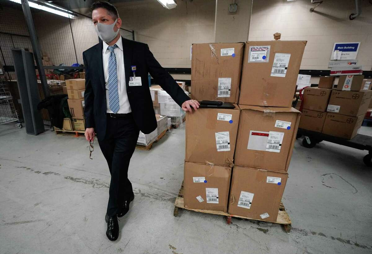 Daniel Metzen, system director of pharmacy at Houston Methodist Hospital, waits at the loading dock for the hospital's first delivery of the COVID-19 vaccine on Tuesday, Dec. 15, 2020.