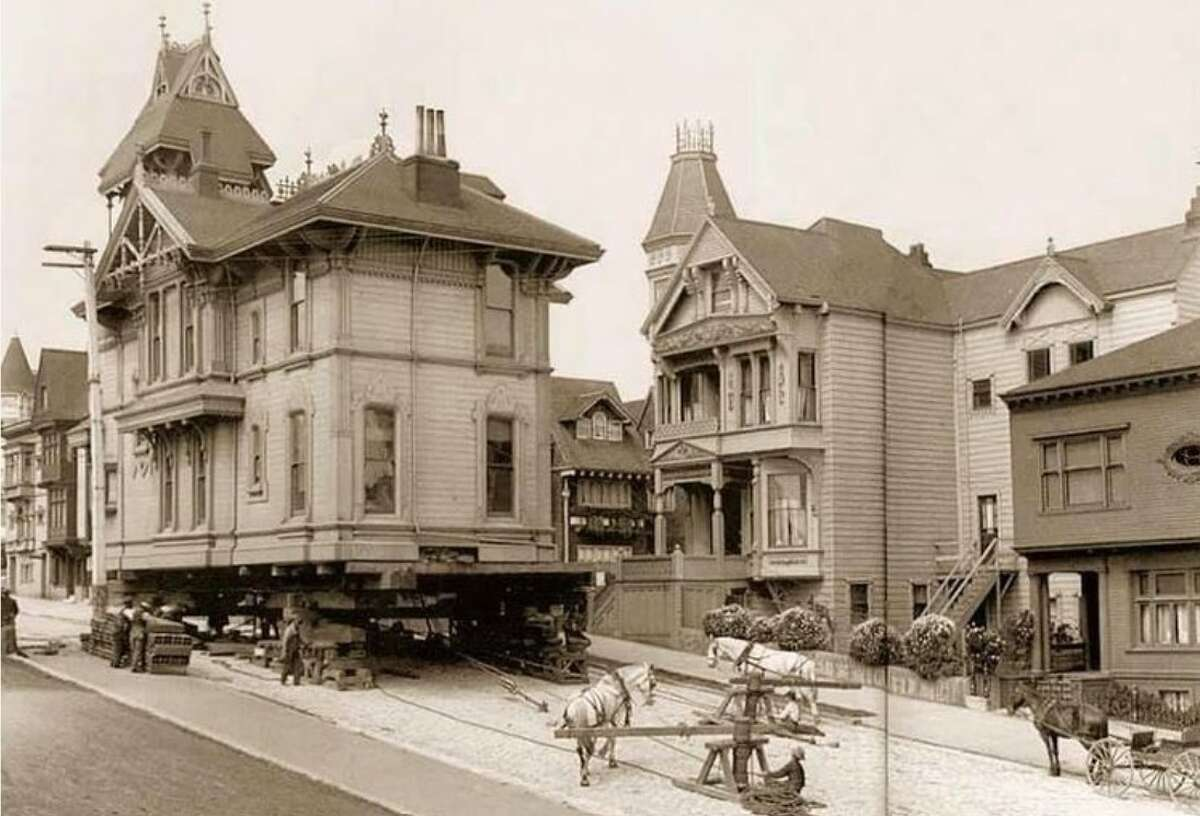 A Victorian home being moved on Steiner Street via horse power, 1908, San Francisco.