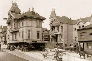 A Victorian home being moved on Steiner Street via horse power, 1908, San Francisco