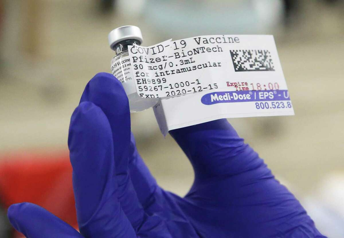 A container holding five doses of Pfizer's COVID-19 vaccine.
