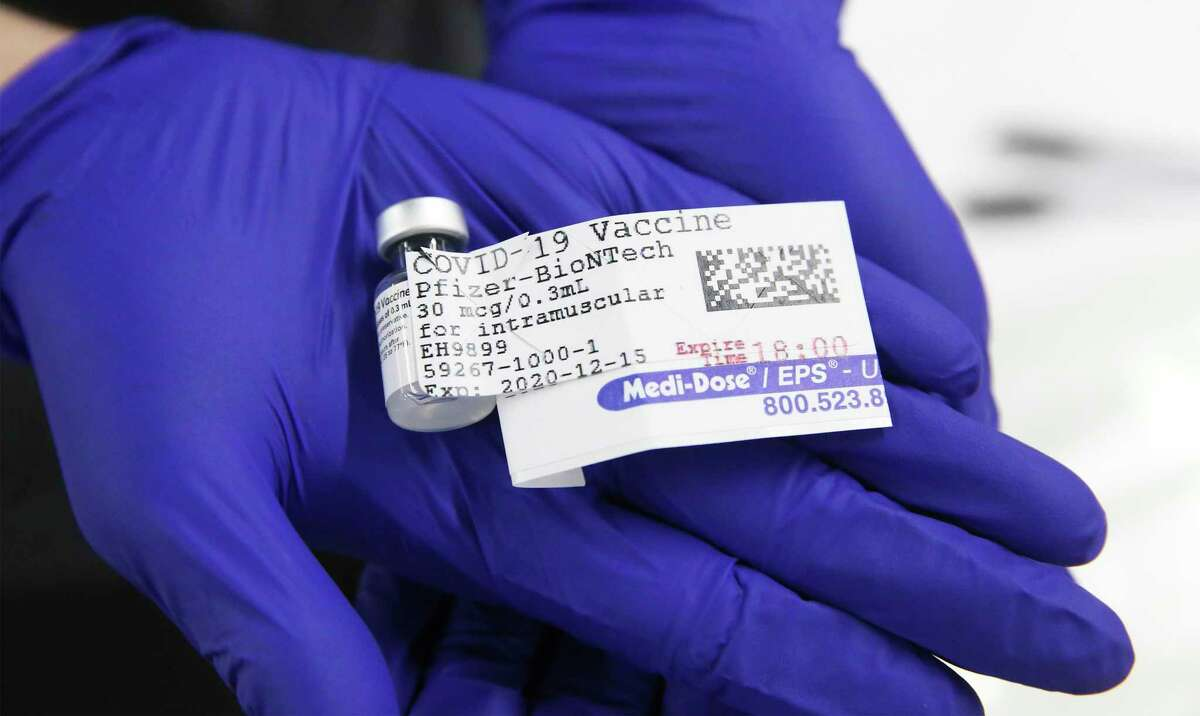 A container holding five doses is shown as UT Health San Antonio.