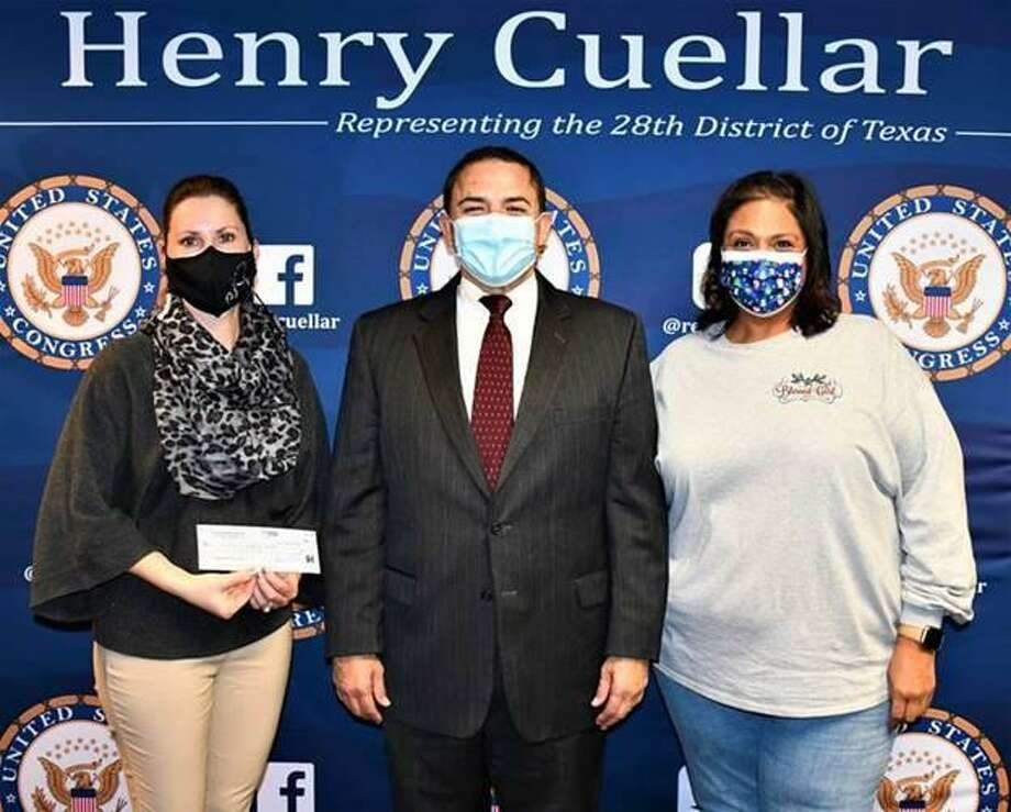 Pictured from left to right is Dr. Henry Cuellar Elementary School Principal Andrea Sanchez, Congressman Cuellar and Dr. Henry Cuellar Elementary School teacher Rebecca Briones. Photo: Courtesy /Rep. Henry Cuellar's Office
