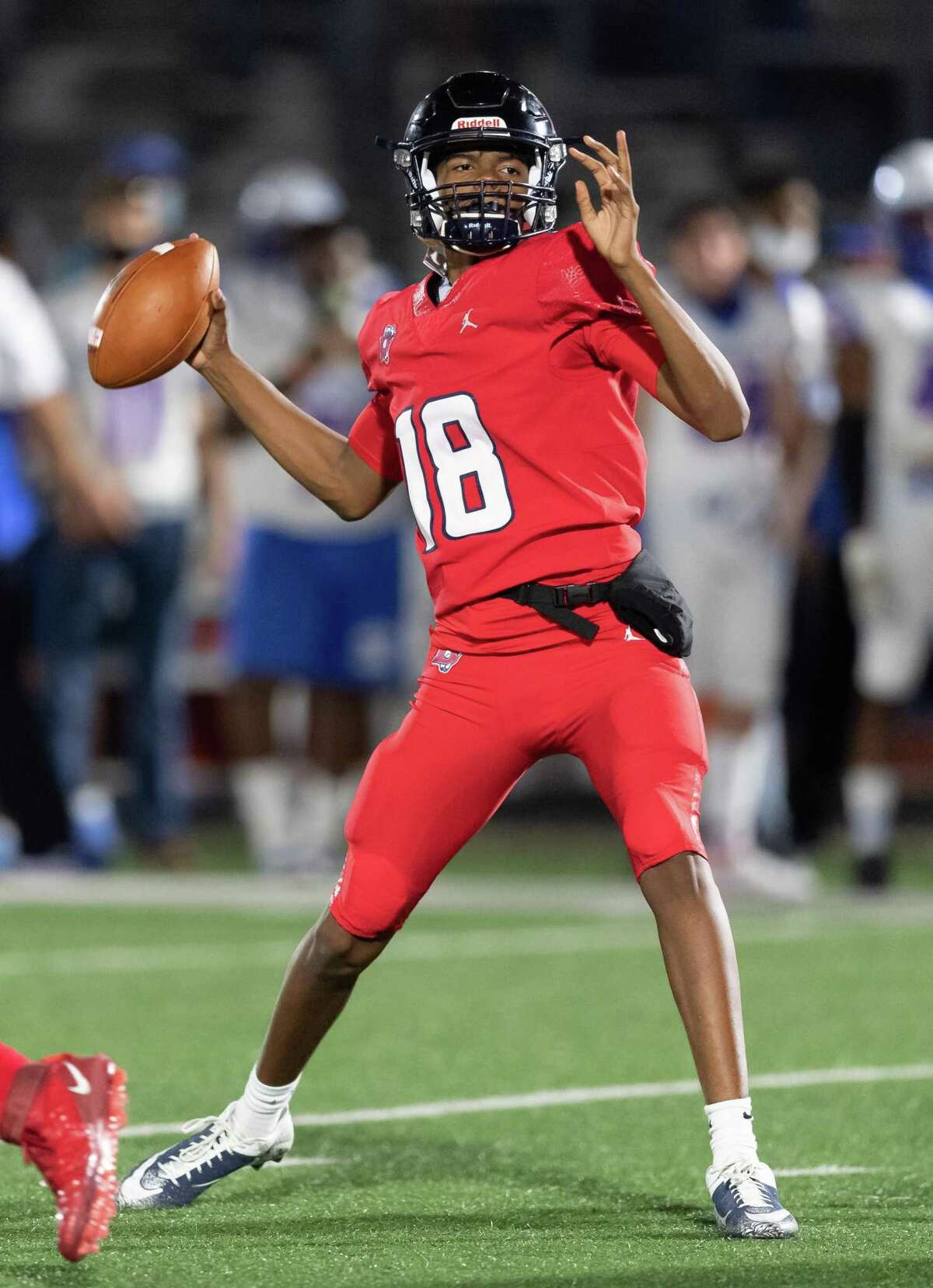 Colin Johnson (18) of the Dawson Eagles attempts a pass in the second half against the Dickinson Gators during a High School bi-district playoff football game on Thursday, December 10, 2020 at Pearland ISD Stadium in Pearland, Texas.