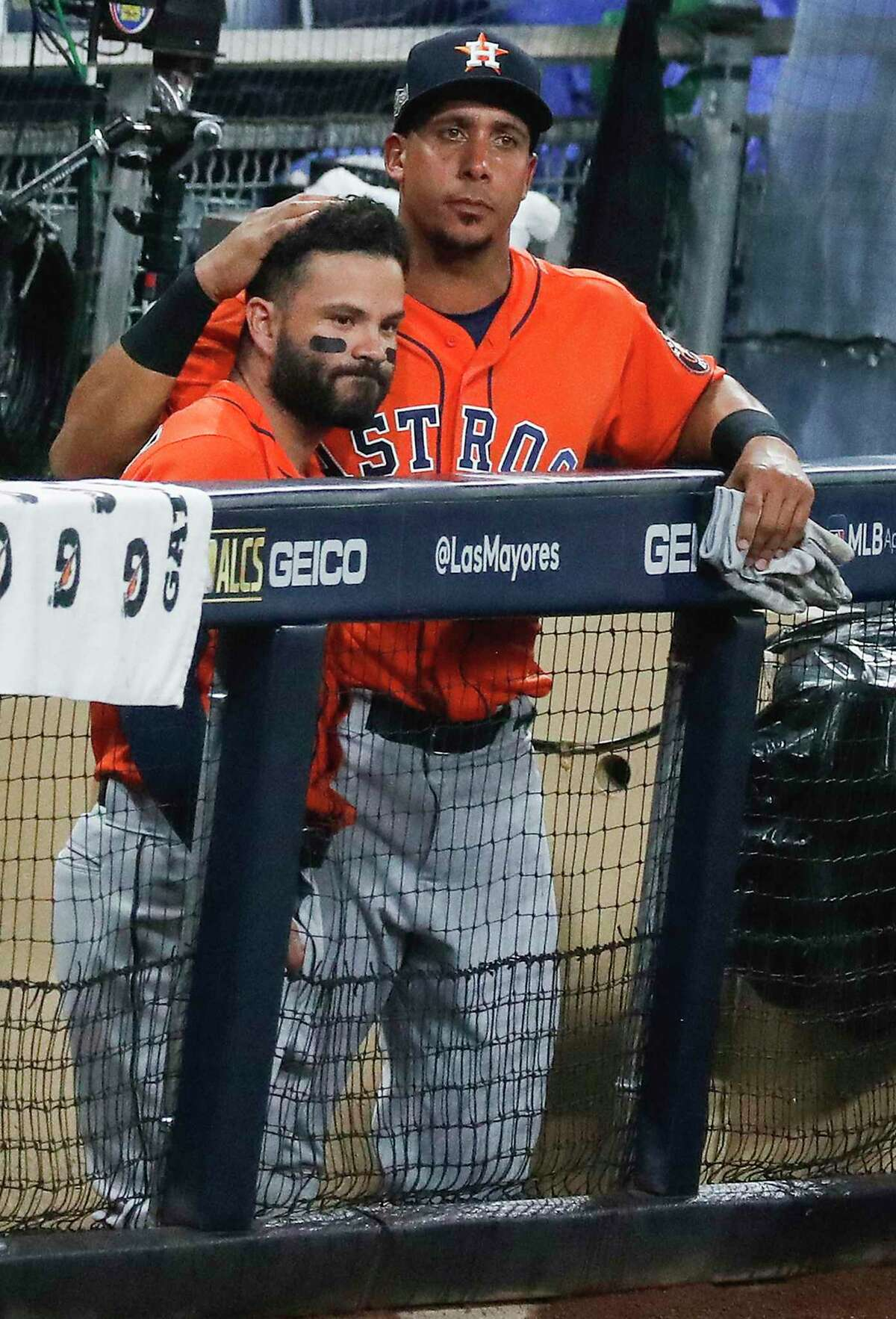 Jose Altuve commiserates with Michael Brantley after the Astros were eliminated from the 2020 postseason by a Game 7 ALCS loss to the Tampa Bay Rays.