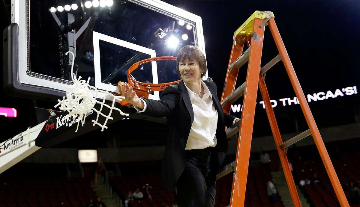 Stanford head coach Tara VanDerveer tosses down the net after finishing cutting it down after the team beat UCLA in the championship game of an NCAA college basketball game in the Pac-12 Conference tournament Sunday, March 10, 2013, in Seattle. Stanford won 51-49. (AP Photo/Elaine Thompson)