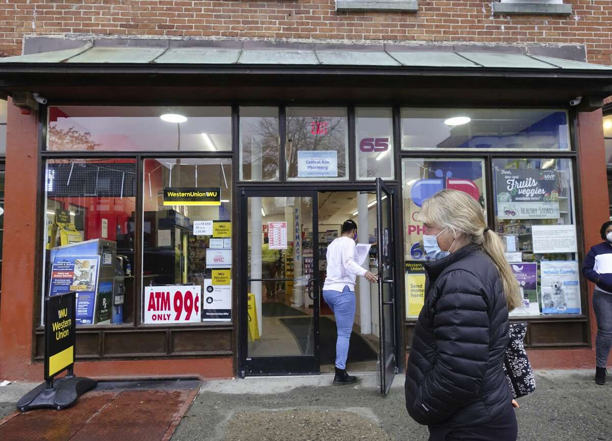 Marbry Gansle of Loudonville waits outside the Central Ave. Pharmacy for her Covid-19 test results on Monday, Dec. 14, 2020, in Albany, N.Y. Gansle returned from a trip to Florida and needed to get tested now that she is back in New York State. Gansle came to the Central Ave. Pharmacy because she could get results the same day. (Paul Buckowski/Times Union)