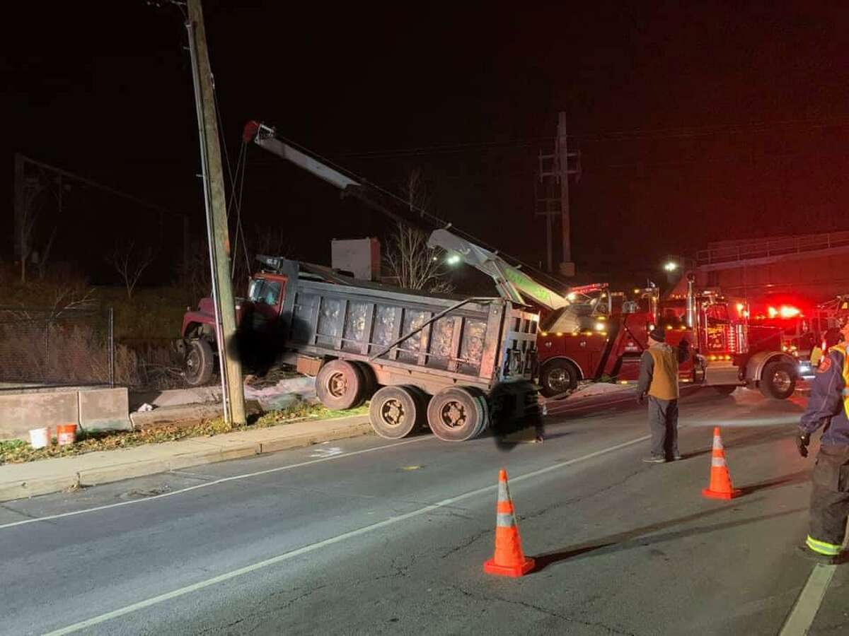 Branford authorities said Tuesday, Dec. 15 2020 they are investigating after a fully loaded dumptruck crashed. The driver escaped with minor injuries, and no other vehicles were struck in the accident, according to fire officials.