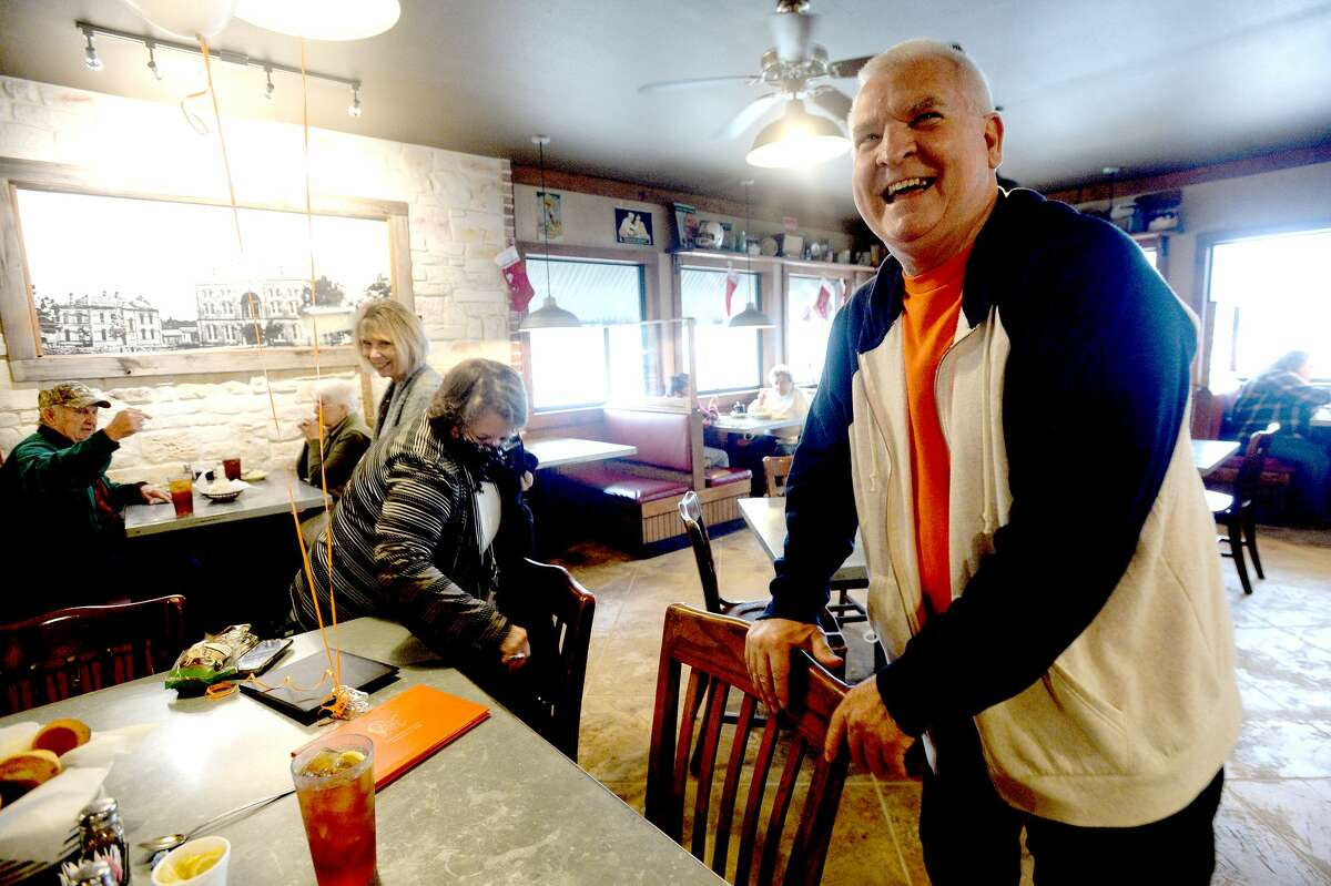 Kent Shaffer laughs was he arrives to officially receive his French High Shool diploma fromhis then principal Jim Boone at Elijah's Cafe in Woodville Tuesday. Photo taken Tuesday, December 15, 2020 Kim Brent/The Enterprise