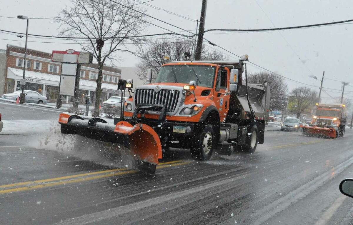 State of Connecticut plow trucks make a pass along Main Ave. in Norwalk Conn. as snow falls on Wednesday March 8, 2018 in Norwalk Conn.