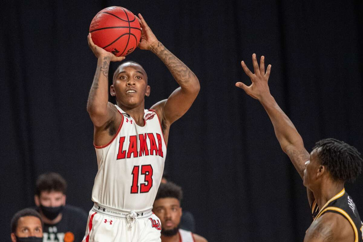 Cardinals Davion Buster (13) pulls up for a shot in the second half. The Lamar Cardinals men's basketball team hosted the Southern Mississippi Golden Eagles at the Montagne Center Tuesday night. Photo made on December 15, 2020. Fran Ruchalski/The Enterprise