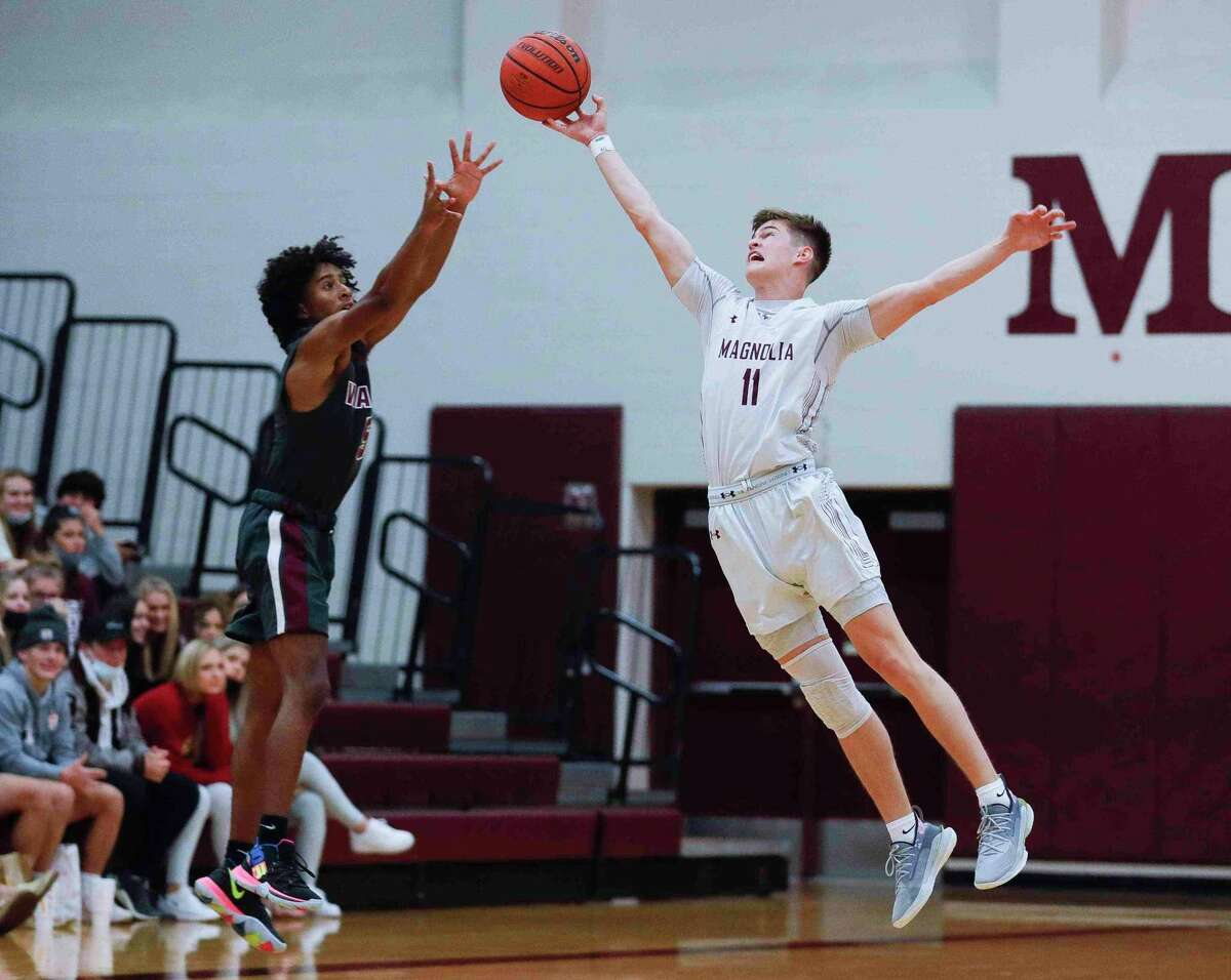 Magnolia senior Connor Lindvall (11) gets a hand on a shot as the Bulldogs opened up District 19-5A play against Waller at home on Tuesday, Dec. 15, 2020.