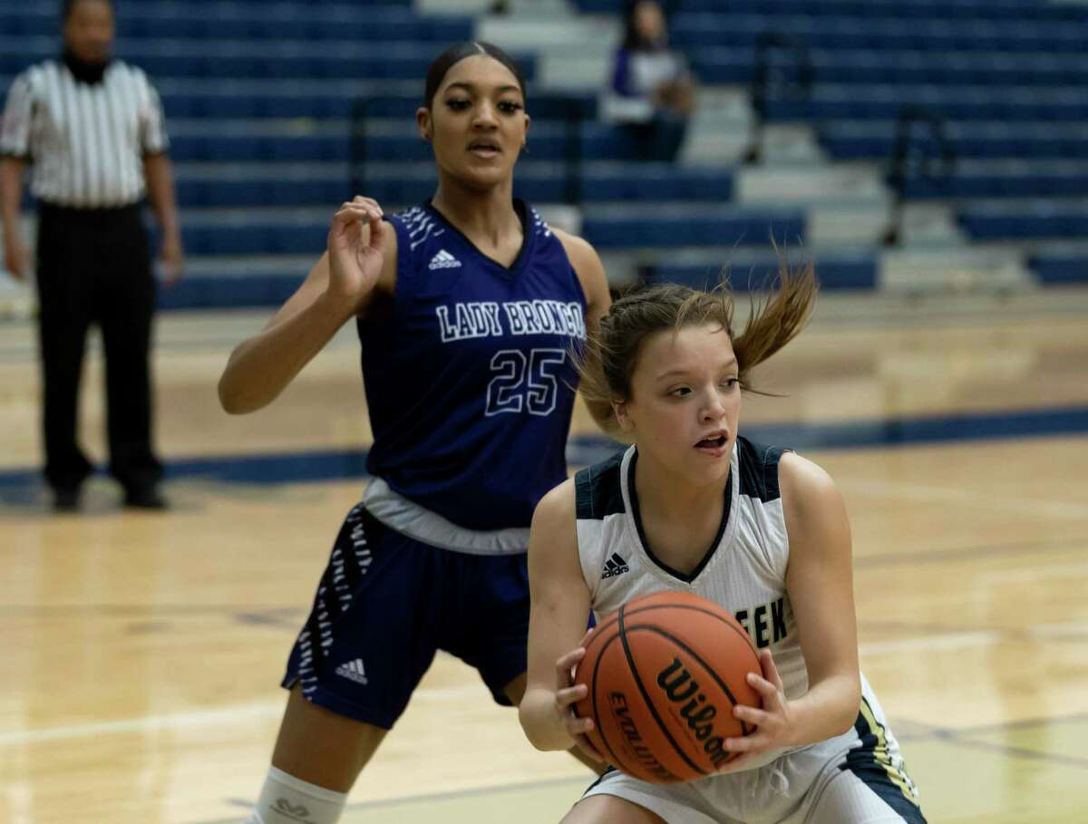 Lake Creek shooting guard Kennedy Oliver (5) looks for an opening to pass the ball while under pressure from Dayton power forward Loryn Mallet (25) during the first quarter of a non-district girls basketball game at Lake Creek High School, Tuesday, Dec. 15, 2020, in Montgomery.