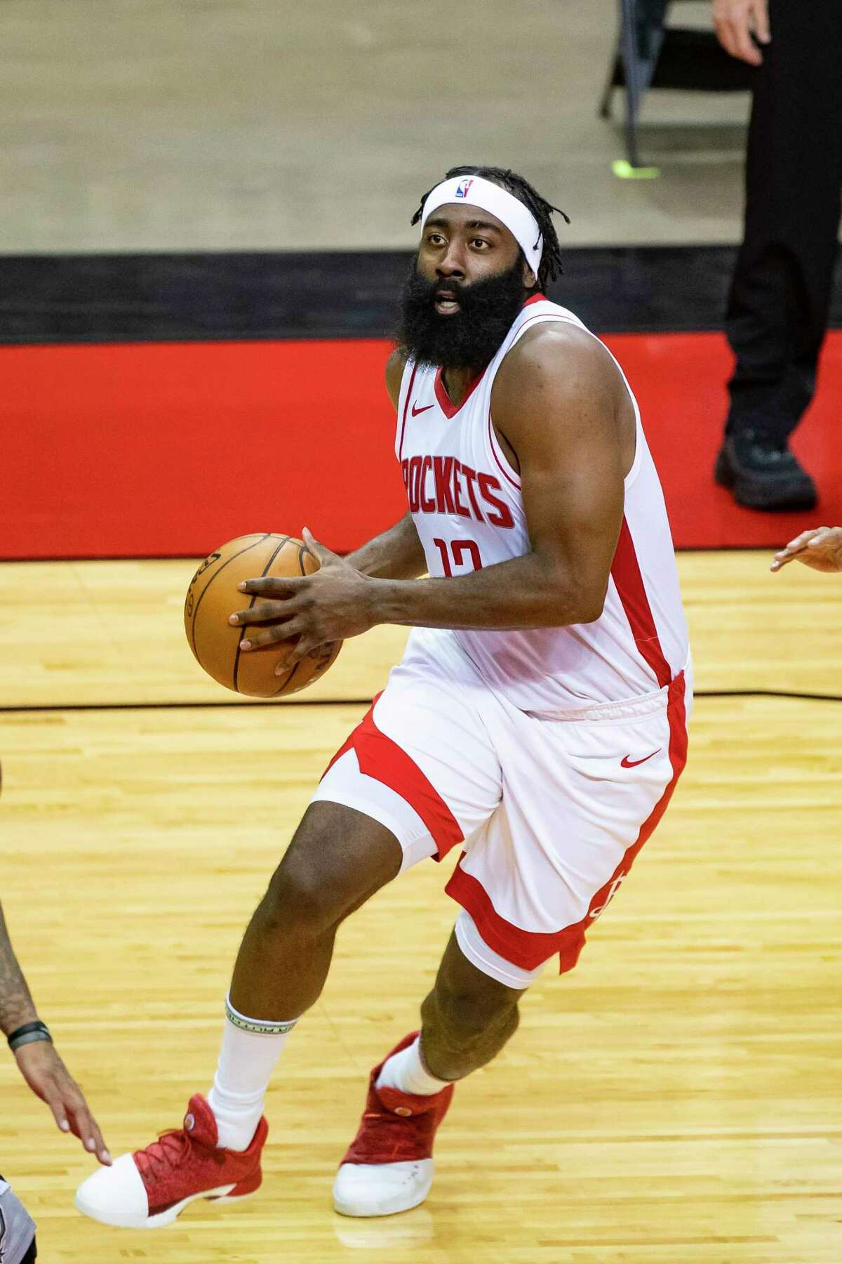 Houston Rockets guard James Harden (13) drives during the first half of a preseason game between the Houston Rockets and San Antonio Spurs on Tuesday, Dec. 15, 2020, at Toyota Center in Houston.