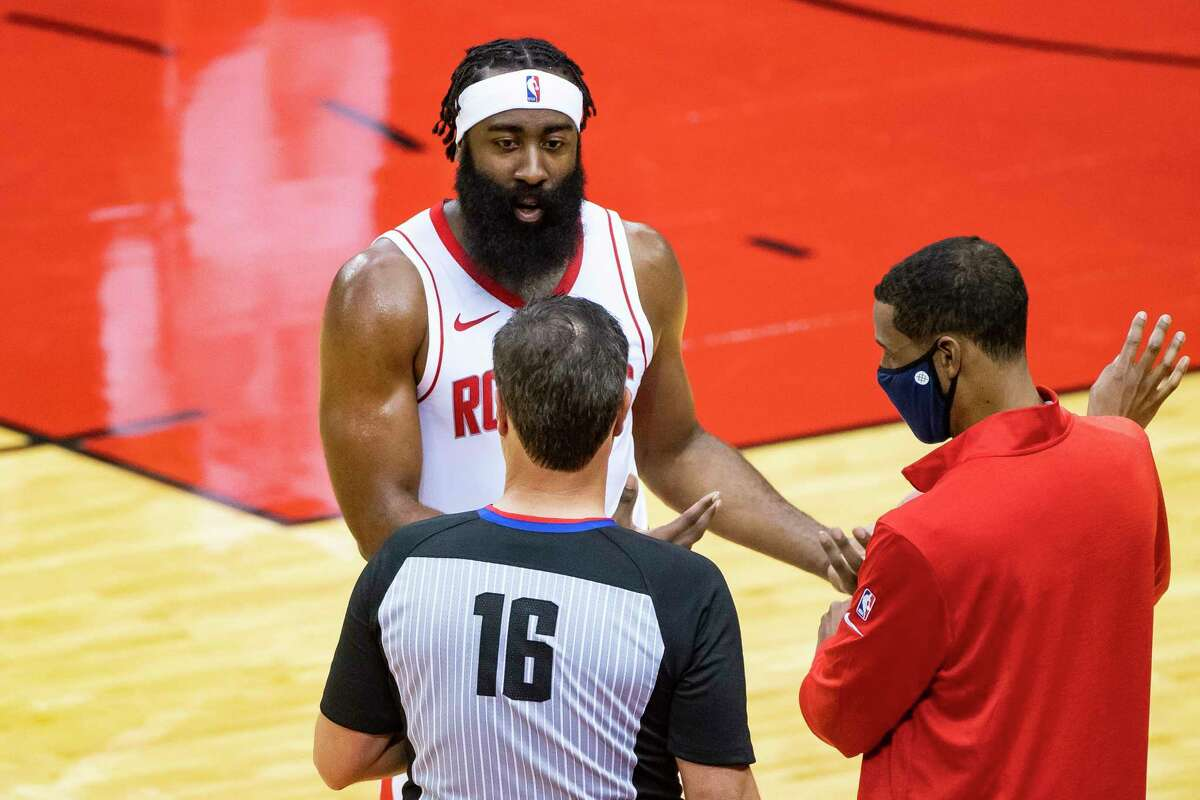 Houston Rockets head coach Stephen Silas and Houston Rockets guard James Harden (13) argue with an official during the first half of a preseason game between the Houston Rockets and San Antonio Spurs on Tuesday, Dec. 15, 2020, at Toyota Center in Houston.