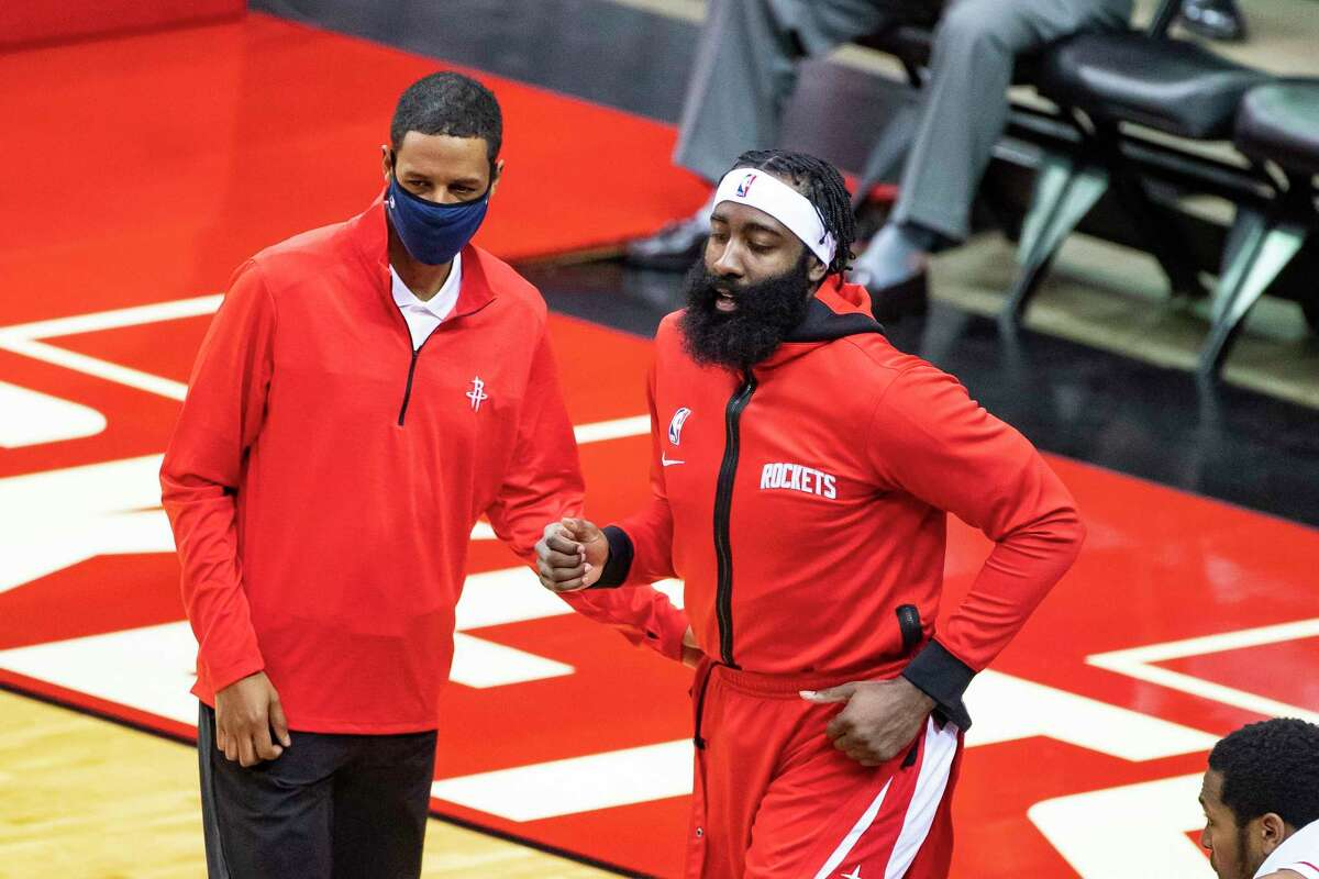 Houston Rockets head coach Stephen Silas calls Houston Rockets guard James Harden (13) back onto the floor during the first half of a preseason game between the Houston Rockets and San Antonio Spurs on Tuesday, Dec. 15, 2020, at Toyota Center in Houston.
