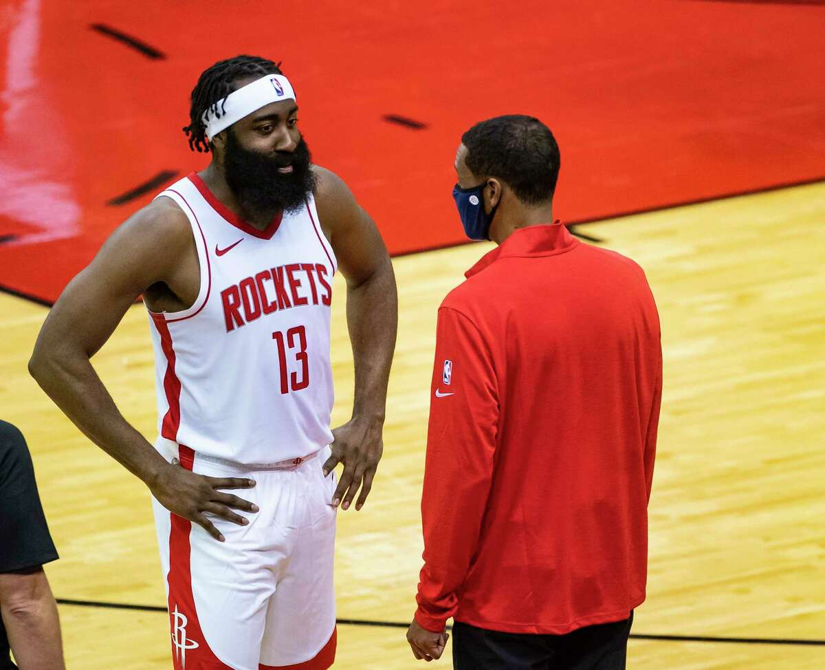 Houston Rockets head coach Stephen Silas and Houston Rockets guard James Harden (13) talk during the first half of a preseason game between the Houston Rockets and San Antonio Spurs on Tuesday, Dec. 15, 2020, at Toyota Center in Houston.