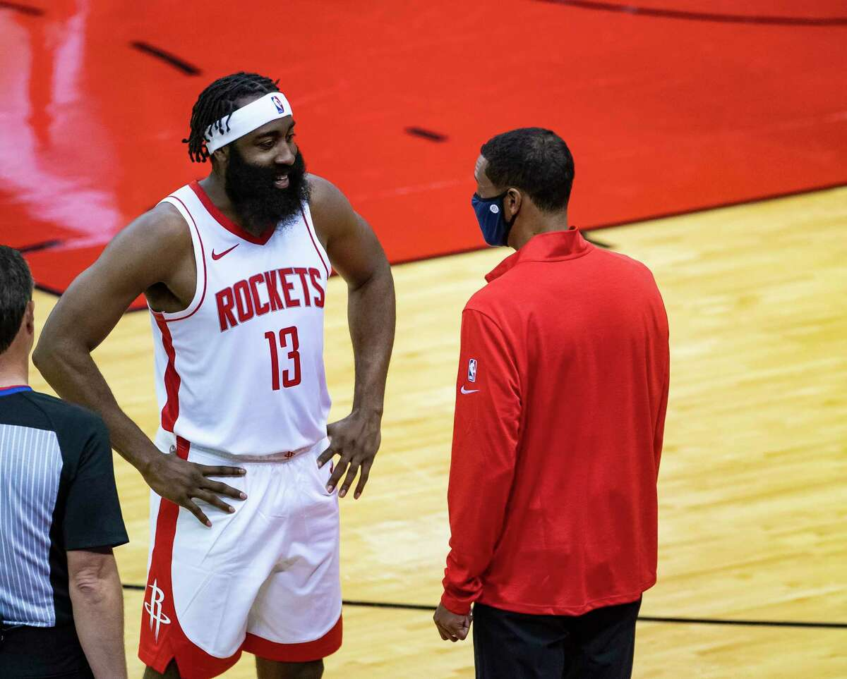 James Harden chats with new Rockets coach Stephen Silas during Tuesday's preseason win over the Spurs. The game was their first together since Harden reported to training camp.