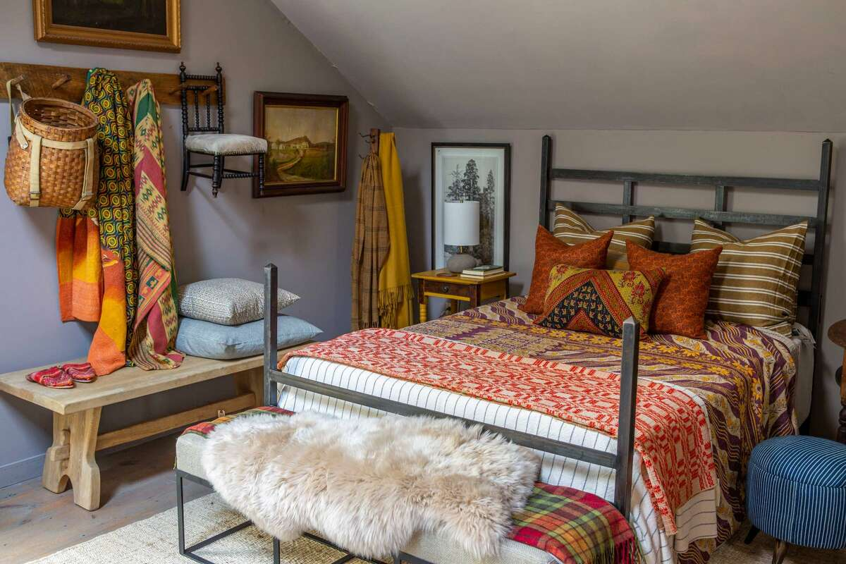 Pillows, blankets, and brightly colored objects are another way to add oomph to a room, says Joan Osofsky, founder and owner of Hammertown furniture and design stores.