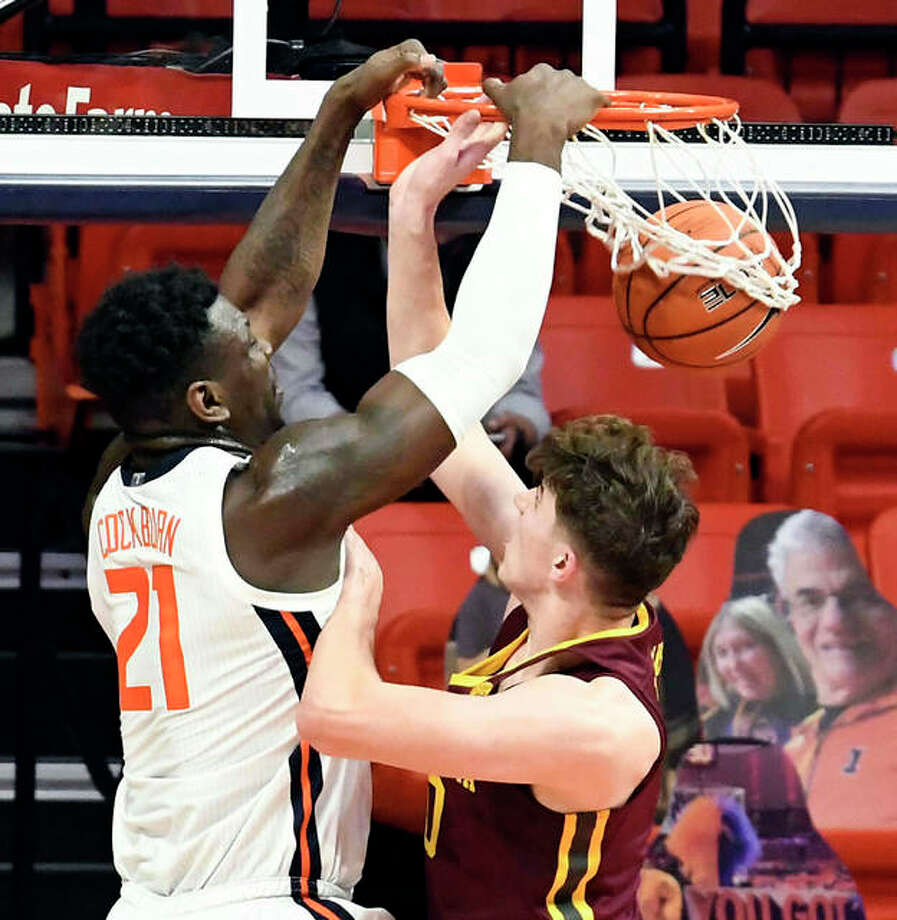 Illinois center Kofi Cockburn (21) dunks on Minnesota's center Liam Robbins (0) in the second half of an NCAA college basketball game Tuesday, Dec. 15, 2020, in Champaign, Ill.