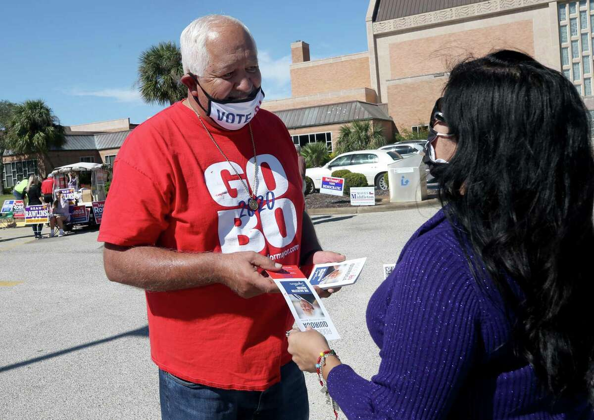 """Galveston mayoral candidate Roger """"Bo"""" Quiroga talks with Mary Limones outside a polling location at Moody Methodist Church, 2803 53rd St., in Galveston on Tuesday, Nov. 3, 2020."""