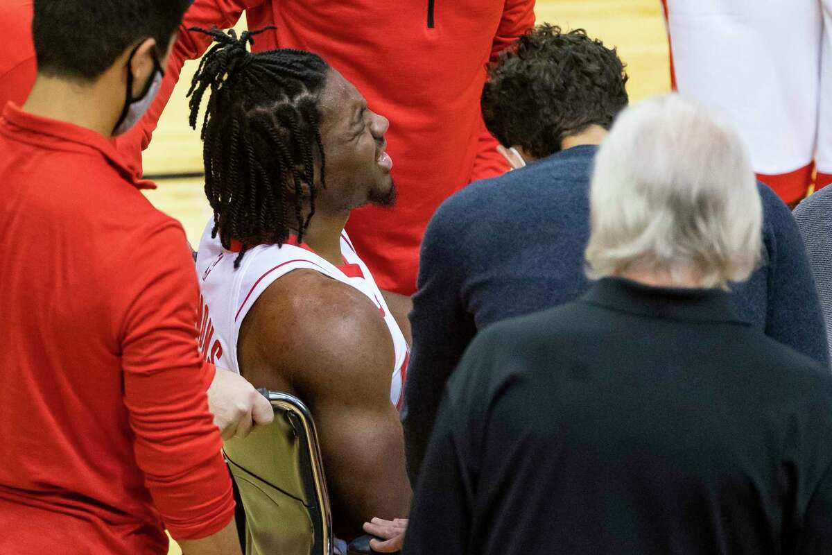 Rockets guard Chris Clemons is helped off the floor after suffering an Achilles injury during Tuesday's preseason game at Toyota Center.