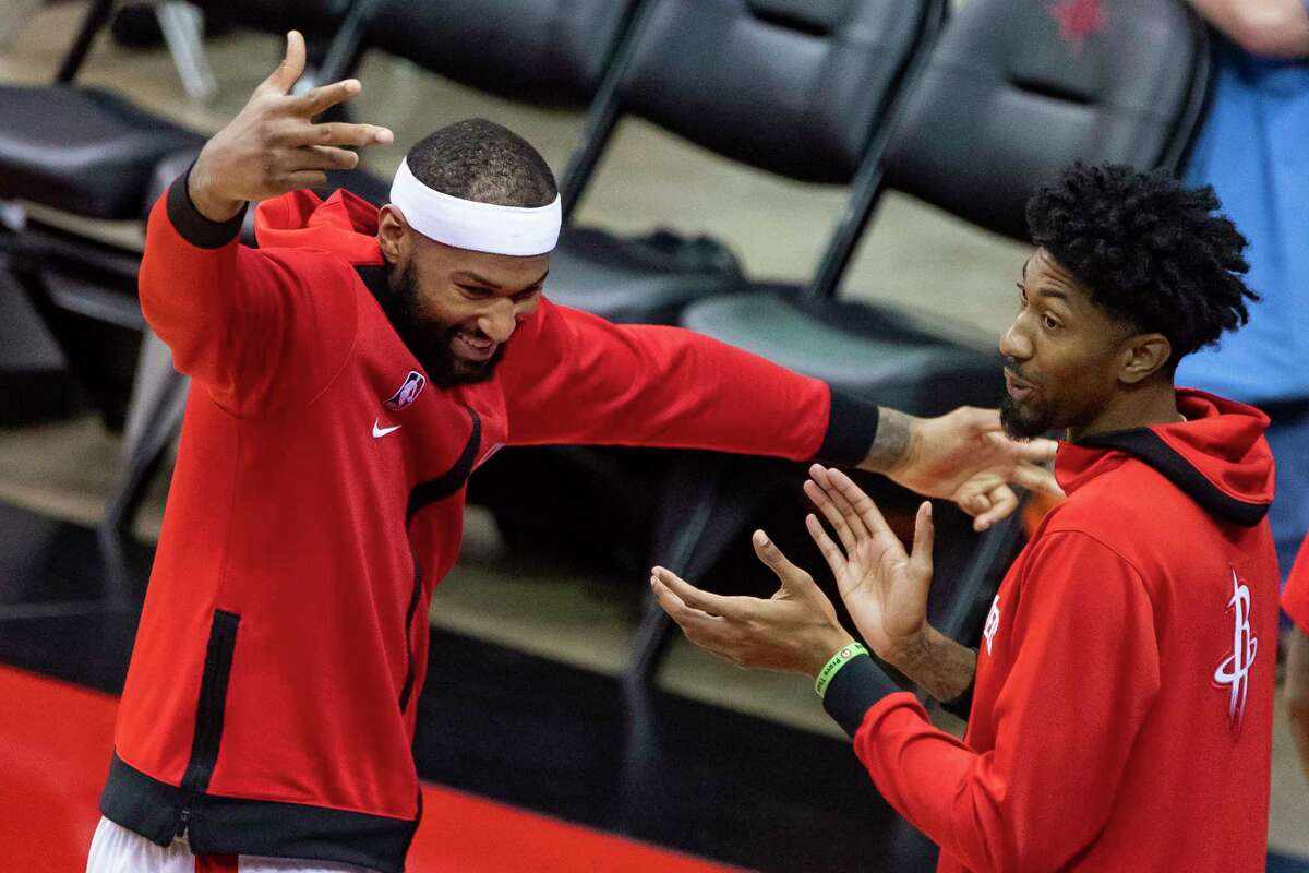 Houston Rockets center DeMarcus Cousins (15) and forward Christian Wood (35) react from the sideline after a shot by Houston Rockets forward Bruno Caboclo (5) during the second half of a preseason game between the Houston Rockets and San Antonio Spurs on Tuesday, Dec. 15, 2020, at Toyota Center in Houston.