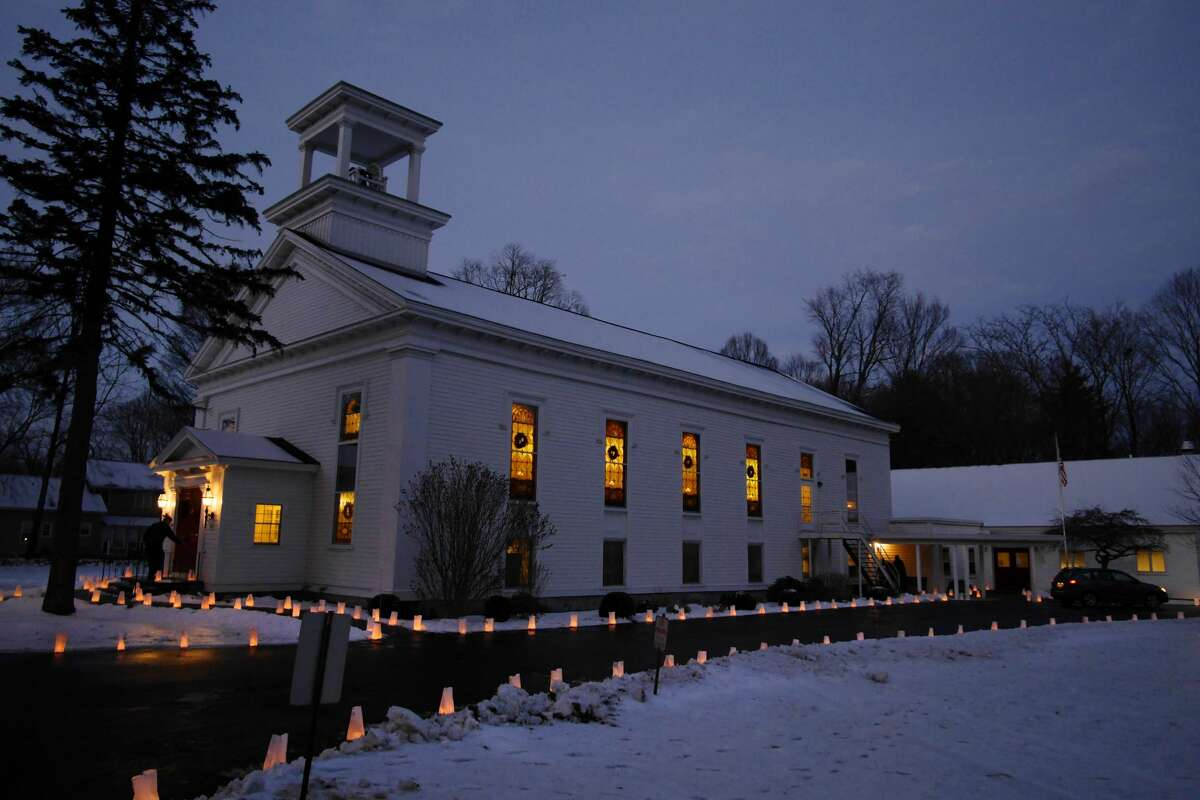 Luminaries are seen outside the Jonesville United Methodist Church on Sunday, Dec. 24, 2017, in Clifton Park, N.Y. Congregations across the Capital Region have had to alter Christmas services and celebrations because of the pandemic. (Paul Buckowski / Times Union)