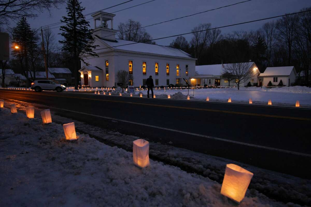Luminaries are seen outside the Jonesville United Methodist Church on Sunday, Dec. 24, 2017, in Clifton Park, N.Y. For the past 35 years members of the Methodist Youth Fellowship at the church have been holding the Luminaria Lighting Tradition on Christmas Eve. The luminaries are placed all around the church and thousands more are bought by community members to line outside their homes too. The money raised is used to fund youth group activities including a week-long work camp in the summer where the children travel to help a community with fixing up homes. (Paul Buckowski / Times Union)